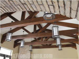 Amazing truss design created with faux wood ceiling beams