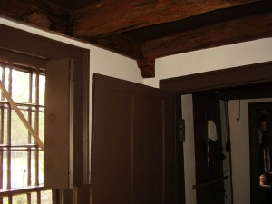 Faux wood corbels complement the real wood detailing in this historic home.