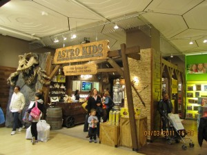 FAO Schwarz NYC new Astro Kids store designed with faux wood beams and rock veneer panels.