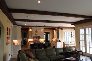 Sitting ceiling makeover with faux beams, corbels and beam straps to mimic real solid beams.
