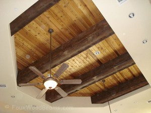 Beams with painted on knots using a darker wood stain.