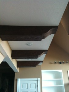 Not only did Kelly create a beautiful truss design, areas of her ceiling throughout her home were accented with faux wood for a unified look.