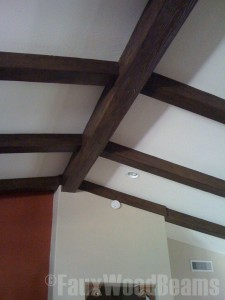 Covering the old fake beams from the 60's with durable polyurethane beams saved on time and money while bringing the home back to its former glory.