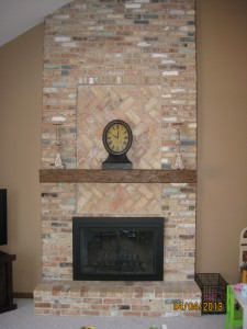 Faux wood fireplace mantels are molded to look just like the real thing but they're far easier to install.