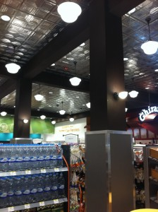 By using artificial wood beams, Walgreens added a beautiful look without all the cost and weight of the real thing.