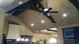 By adding a faux wood truss to her ceiling design, kelly was able to update and beautify the entire space.