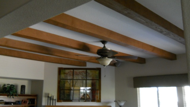 Faux oak ceiling beams installed in the living room of a California home.