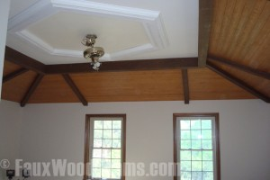 Bedroom tray ceiling remodeled with faux beams and tongue and groove planks.