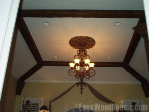 Beams and corbels enhance the coffered ceiling design.
