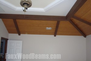 Covering a bedroom's cracking drywall with faux beams and planks.