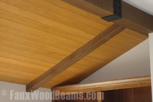Faux ceiling beams paired with tongue and groove planks.