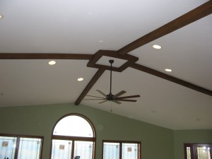 We're impressed with the beautiful ceiling beam design installed expertly on this uneven vaulted ceiling.