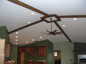 Draw the eyes throw the room with added visual cues from your faux ceiling beams.