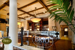 Add charm to restaurant interior designs with faux ceiling beams like Brio Tuscan Grille.