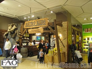 Faux beams frame the entrance into Astro Kids at NYC's FAO Schwarz.