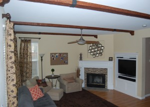 Faux beams line this living room ceiling.