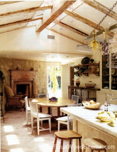 Real reclaimed wood beams add rustic good looks to this sunny kitchen