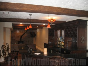 Faux beams installed on a stucco ceiling.
