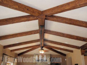 Ceiling beams attached to a smooth ceiling creates a clean line.