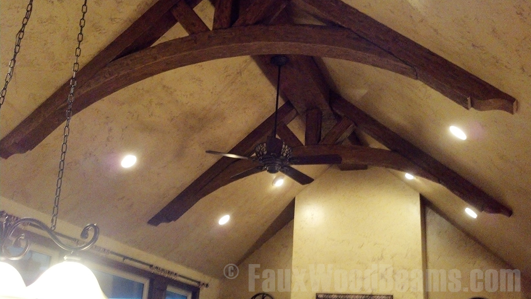 Wood style ceiling trusses with curved bottoms.