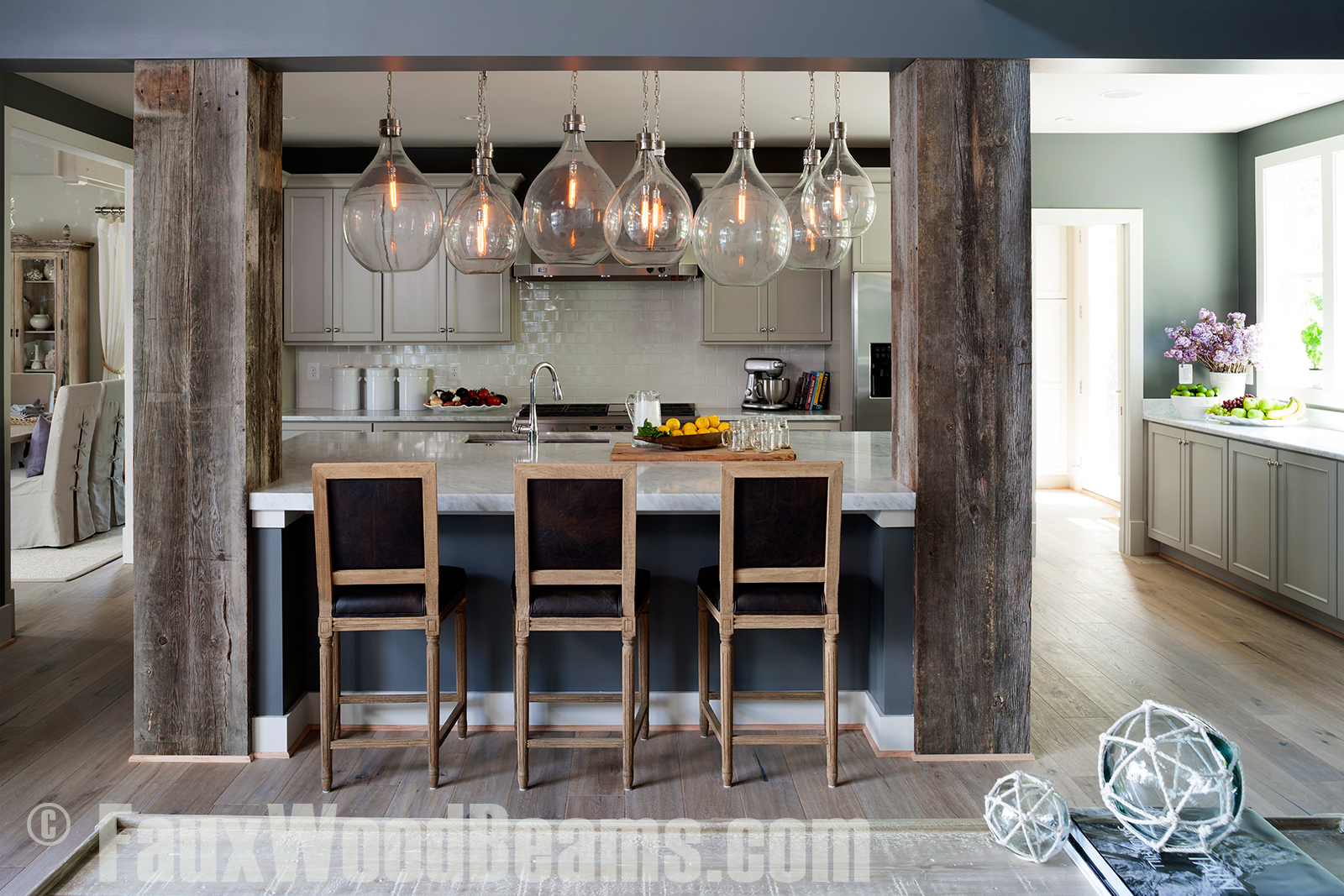 Reclaimed wood box beams give kitchens a beautiful look.