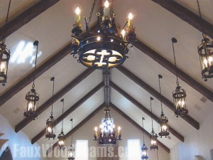 Faux medieval timber beams accentuate the angles of vaulted ceilings.