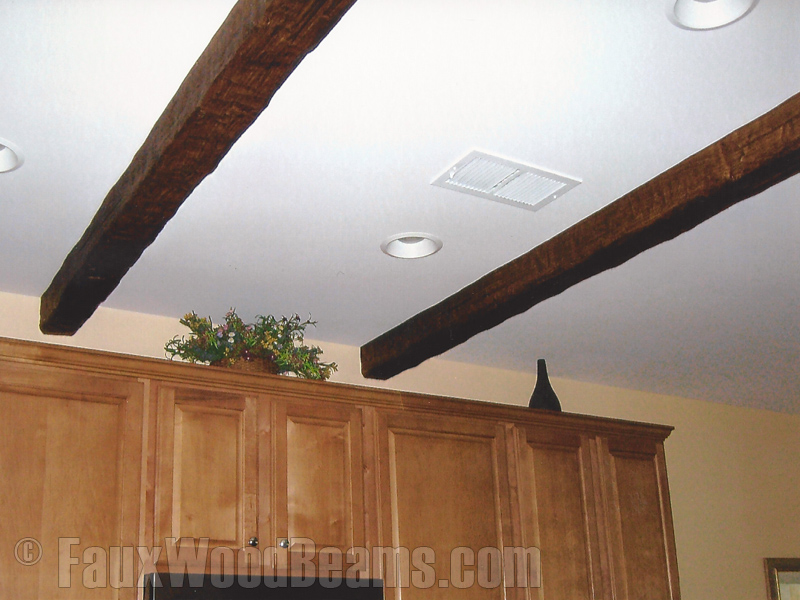 Custom Timber beams add rustic character to the kitchen
