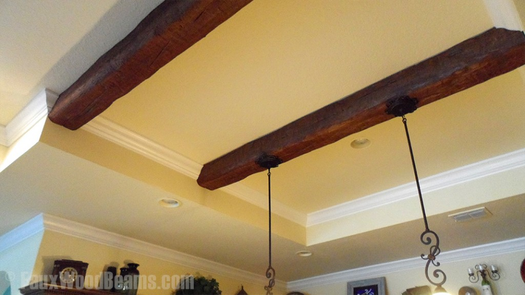 Kitchen recessed ceiling with Custom Timber beams.