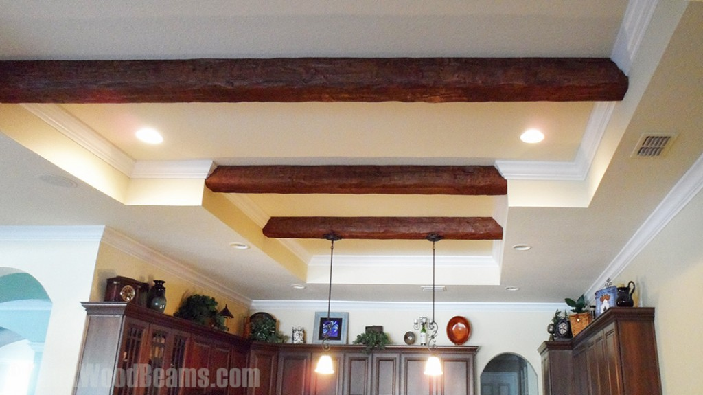 Custom Timber beams installed in a kitchen's recessed ceiling.