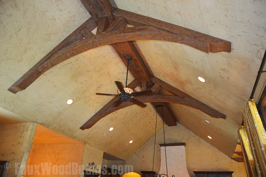 Close up view of living room trusses created with Tuscany arched and straight beams.