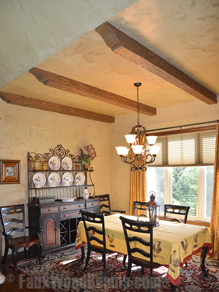 Kelly's dining room with Tuscany beams capped with decorative corbels