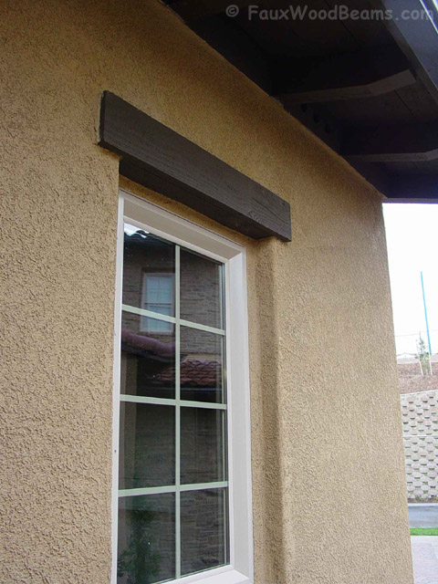 L-Beam window header installed with screws and adhesive with the look of a solid wood beam.