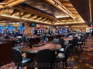 Sandblasted beams accent a tray ceiling above Ameristar Casino's gaming tables