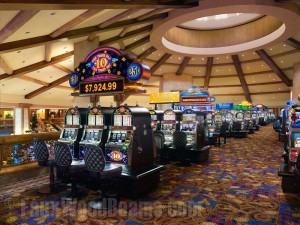 Faux rustic wood beams installed in a spider web pattern on Ameristar's gaming floor in Blackhawk, CO