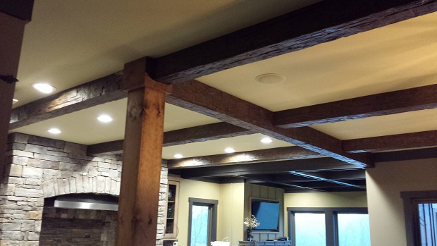 Large white ceiling remodeled with real and faux beams combined.