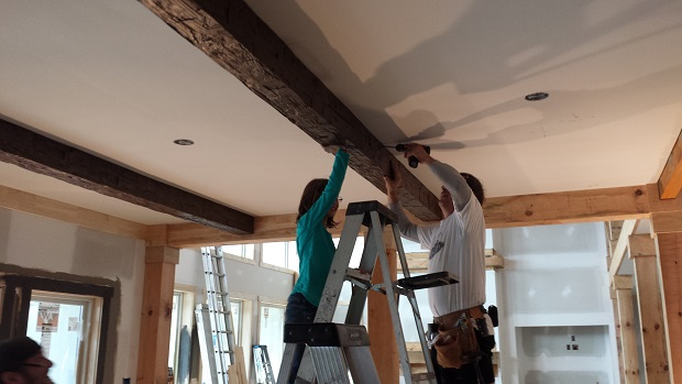 Only two people needed to install lightweight Custom Rough Hewn beams.