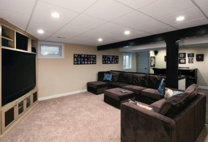 A suspended, or 'drop' ceiling is a common element in finished basements.