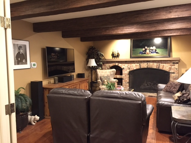 Living room support beams covered in hollow faux Timber beams
