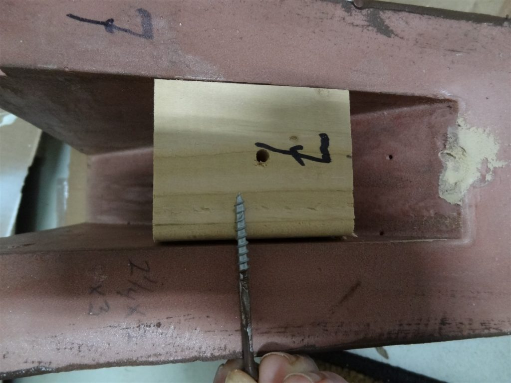 9. Apply screw through corbel into mounting block. Paint screw.