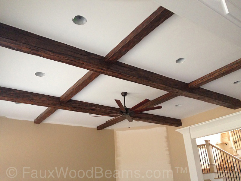 Custom Timber beams installed in a criss-cross pattern on a family room ceiling.