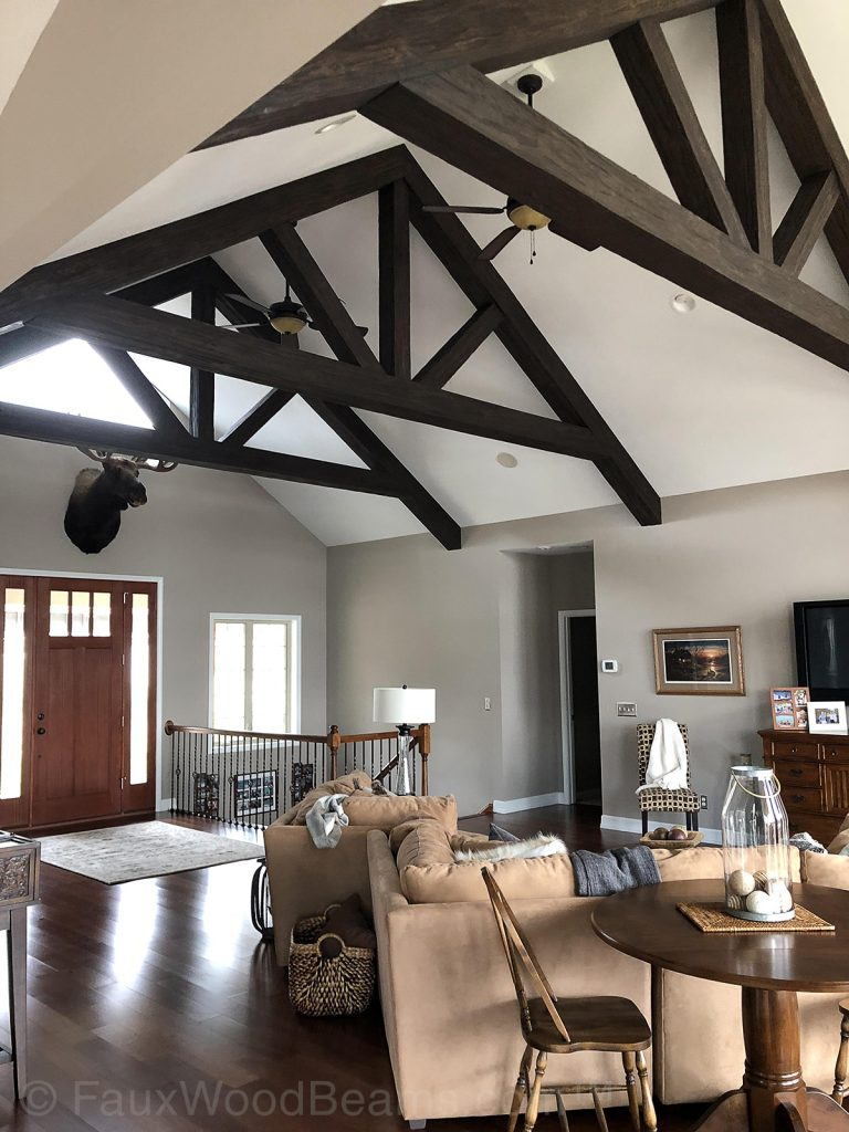 A-frame trusses made from Custom Timber beams installed in a living room.