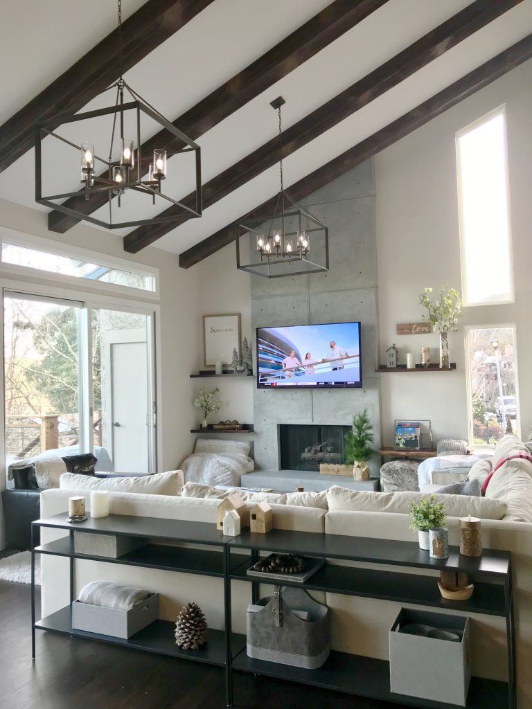 Gorgeous, modern living look design with Beachwood beams, new lighting, sliding doors, furniture and more.