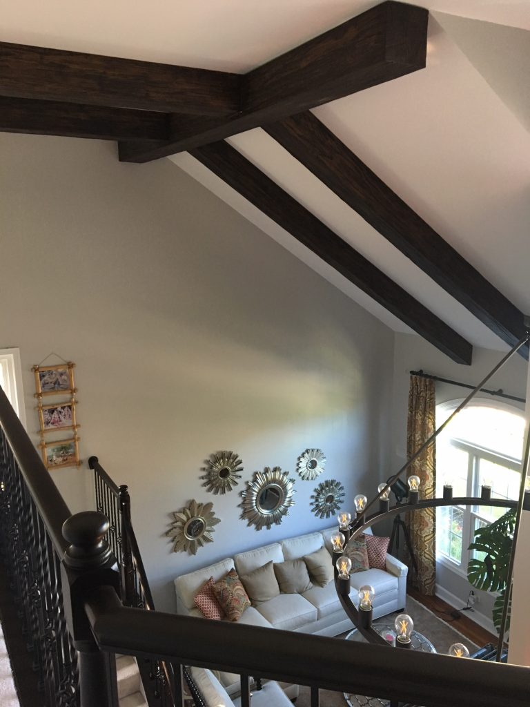 Medieval style added to a living room's high vaulted ceiling with Custom Heritage Beams.