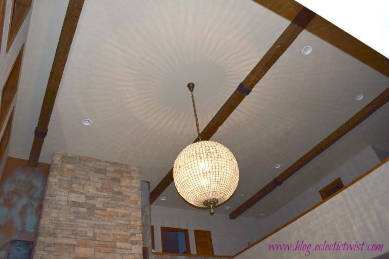 DIY wood beams installed on a home's 20 foot ceiling, project done by Tina of the Eclectic Twist blog.
