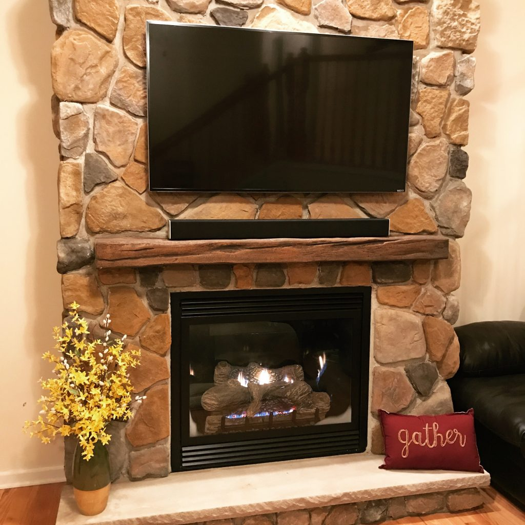 Building a fireplace in her living room was easy for Maryn using faux panels and a Custom Timber mantel.