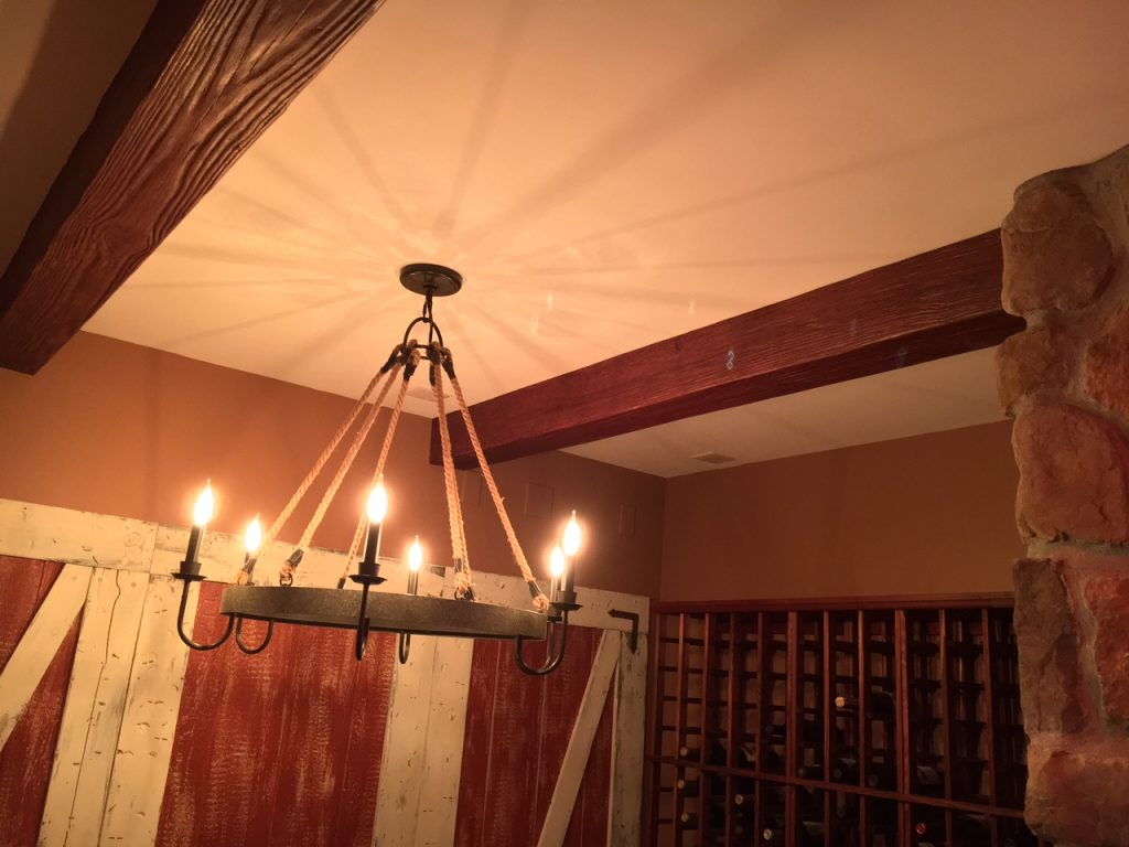 A home wine cellar remodeled with faux sandblasted beams that match the historic decor.