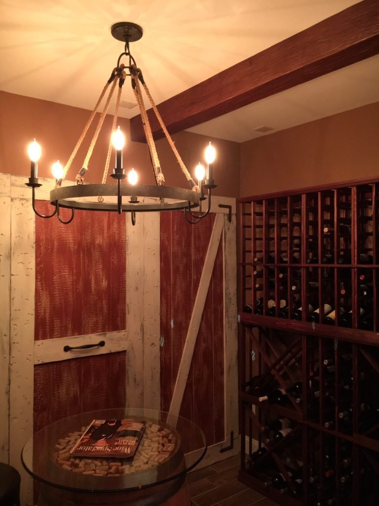 This home wine cellar project seamlessly blend modern beams with an existing, old-world design.