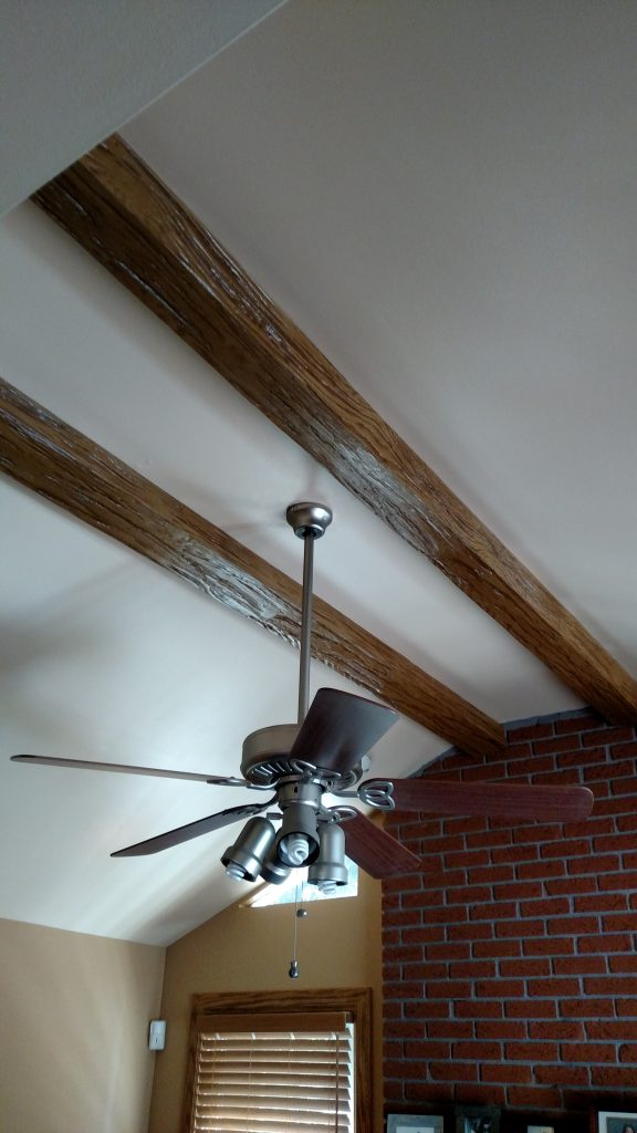 Heritage beams treated with a wood stain washing technique to better match the room's existing wood finishes.