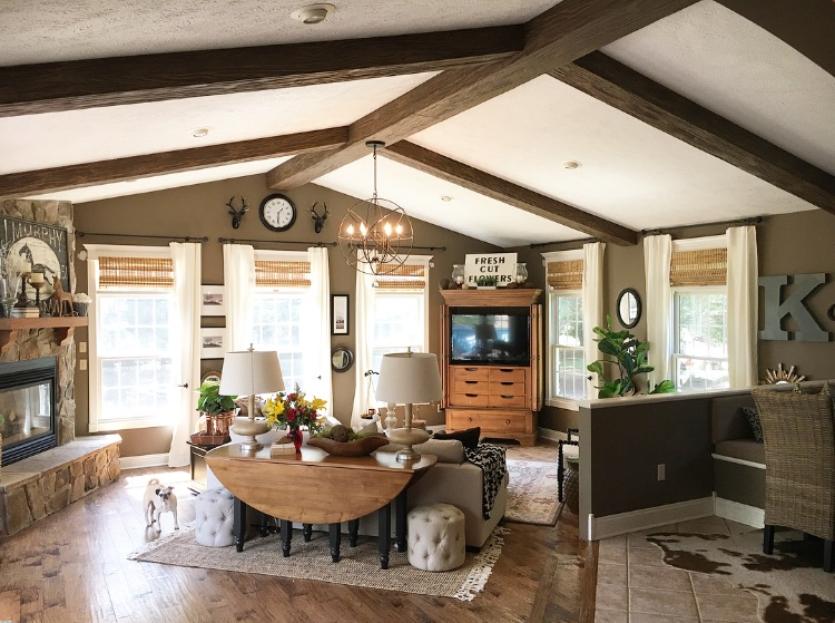 A home's stunning interior redesign included adding Custom Heritage beams to the great room.