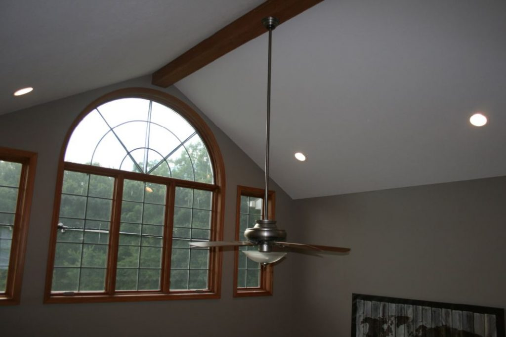 Single Woodland beam installed on a living room's cathedral ceiling